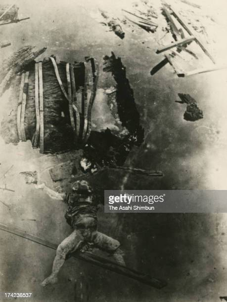 A body of young victim of the Great Kanto Earthquake floats under Houonjibashi Bridge in September 1923 in Tokyo Japan The estimated Magnitude 79...