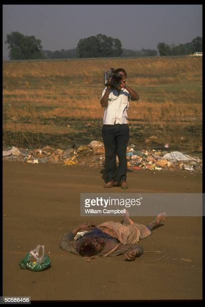 Body of Zulu killed in bloody black township ZuluXhosa rival antiapartheid power struggle being filmed by TV cameraman at Phola Park squatter camp nr...