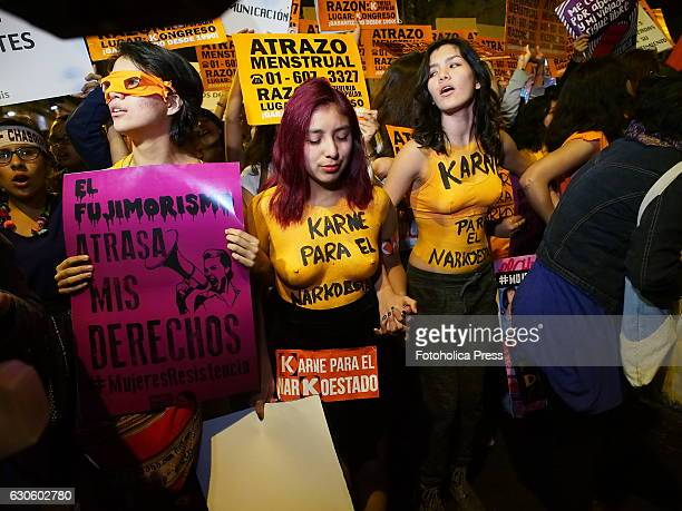 Body painted and bare chested girls rally against Keiko Fujimori candidacy only 5 days before the runoff of general elections Protesters carried...