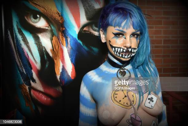 Body painting model Micripta poses topless during the celebration of the Erotic Salon of Barcelona