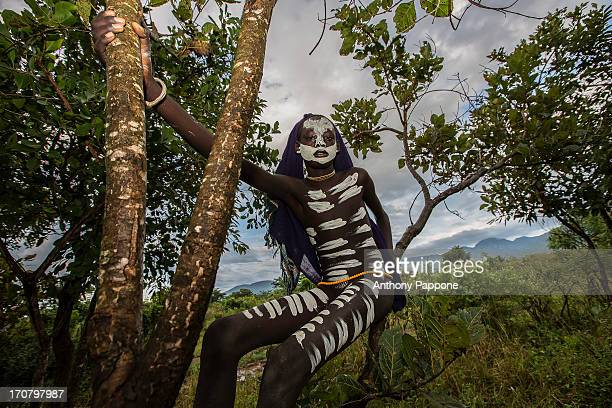 Body painting Surma tribe over the tree in the village near kibish, ethiopia