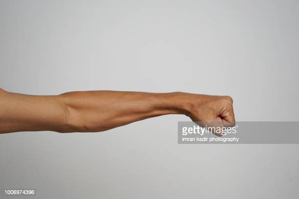 body part cropped hand in grey background - arm stock pictures, royalty-free photos & images