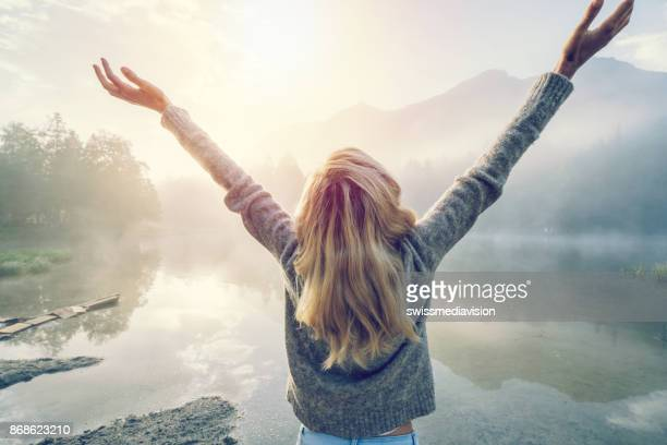Body positive girl enjoying freedom in nature