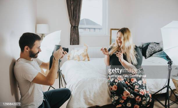 body positive social media icon performs in a small bedroom with her friend as a camera operator - shooting crime stock pictures, royalty-free photos & images