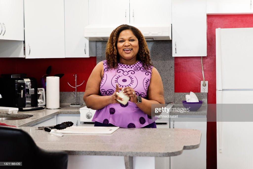 Body positive woman putting on homemade hand cream. : Stock Photo