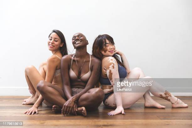body positivity - women friends posing at home in lingerie - lingerie stock pictures, royalty-free photos & images