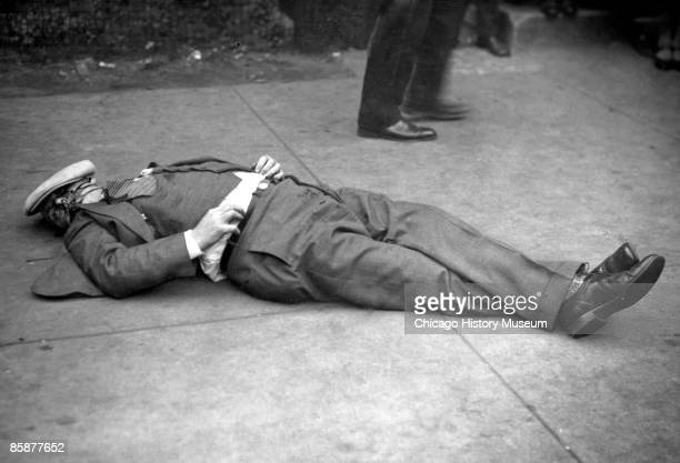 A body possibly that of Earl 'Hymie' Weiss lies on the sidewalk after being gunned down by Capone's gang on State Street October 1926 In the previous...