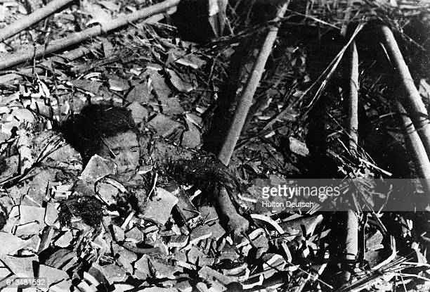 A body protrudes from a sea of rubble left in the wake of the Japanese bombing of Shangahi during the Second SinoJapanese War