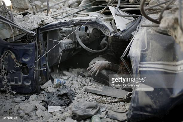 Body remains inside of a crushed car on the streets of downtown Port au Prince on January 18, 2010 in Port Au Prince, Haiti.