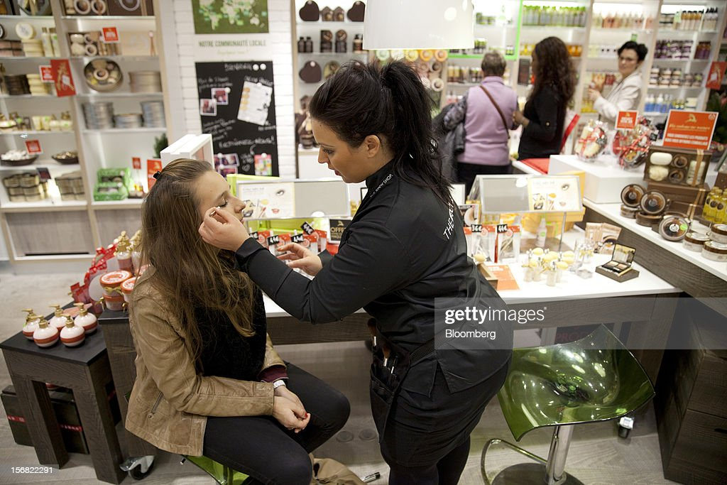 A Body Shop assistant, right, applies make-up to a customer inside the store in Paris, France, on Wednesday, Nov. 21, 2012. Body Shop International Plc Chief Executive Officer Sophie Gasperment has introduced organic lines and updated products like Hemp Hand Protector with Community Fair Trade ingredients after L'Oreal, the world's largest maker of cosmetics, bought the company in 2006. Photographer: Balint Porneczi/Bloomberg via Getty Images