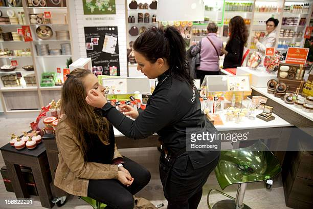 A Body Shop assistant right applies makeup to a customer inside the store in Paris France on Wednesday Nov 21 2012 Body Shop International Plc Chief...