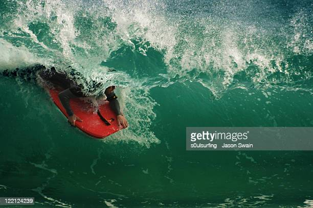 bodyboard rider at  porthcurno - s0ulsurfing stock pictures, royalty-free photos & images