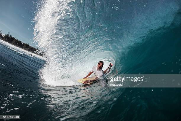 Bodyboarder Riding through tube wave, Puerto Rico, USA