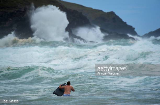 Bodyboarders brave the waves in rough seas at Fistral beach on July 30, 2021 in Newquay, United Kingdom. Storm Evert is the UK's fourth named storm...