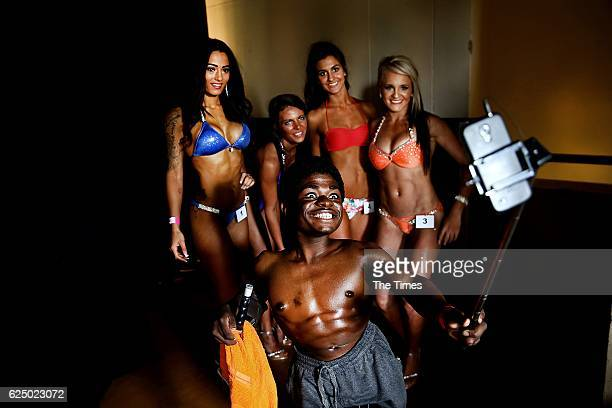 Bodybuilder Caleb Muthombo poses with other athletes before competing in the Summer Superbodies on November 19 2016 in Johannesburg South Africa...