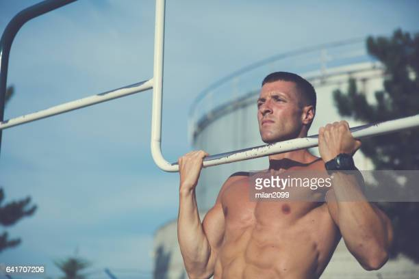 bodybuilder doing pull ups - milan2099 stock photos and pictures