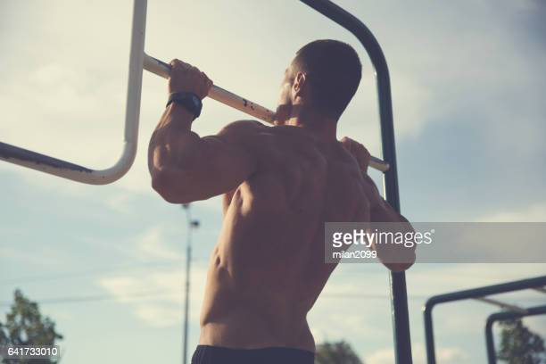 bodybuilder doing pull ups - chin ups stock photos and pictures