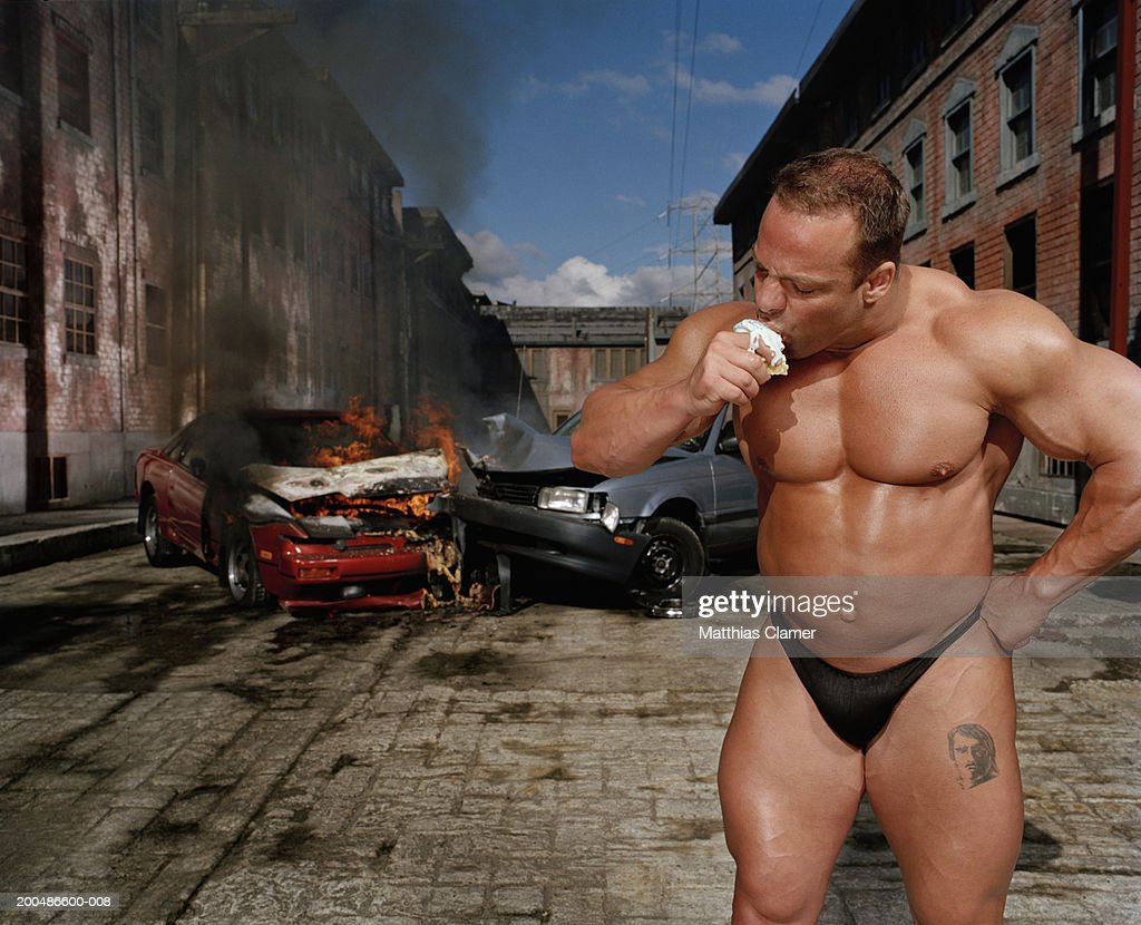 Bodybuilder Eating Ice Cream Cone Car Collision In Background High Res Stock Photo Getty Images