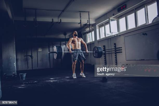 bodybuilder exercise in the gym - snatch weightlifting stock photos and pictures