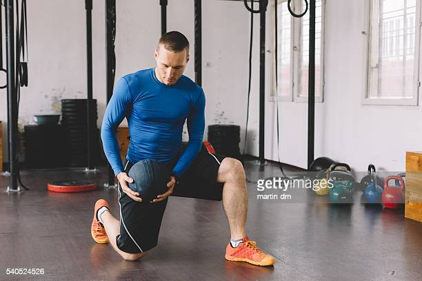 bodybuilder exercising in the gym - medicine ball stock pictures, royalty-free photos & images