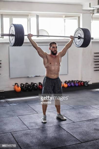 bodybuilder exercising with weights - snatch weightlifting stock photos and pictures