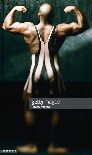 bodybuilder flexing back muscles - leotard stock pictures, royalty-free photos & images