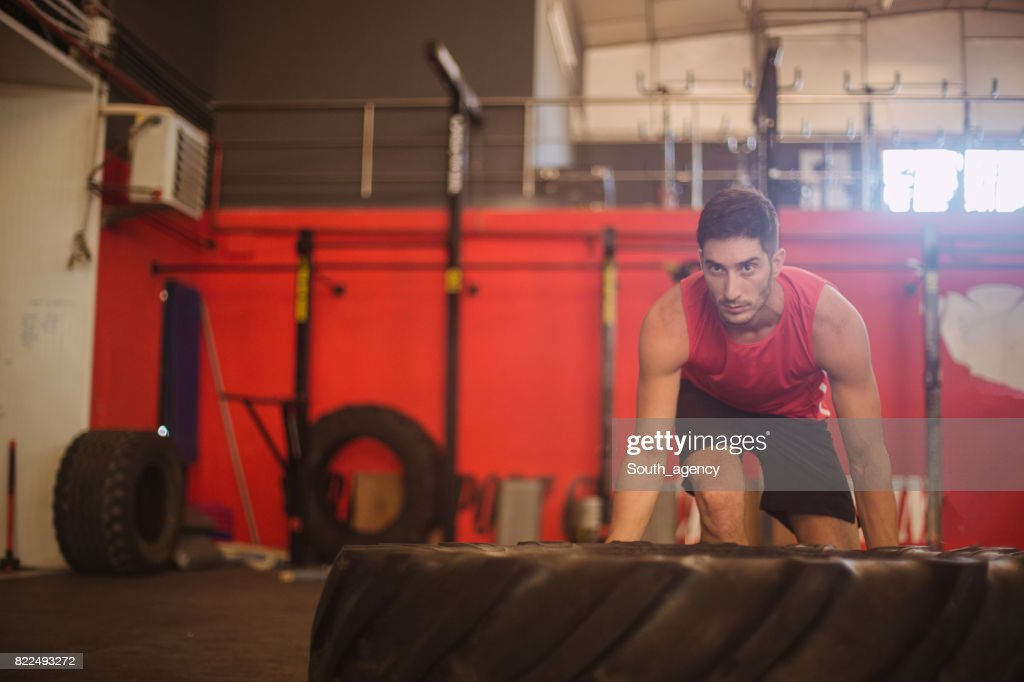 Bodybuilder flipping tire : Stock Photo
