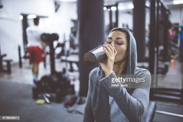 Bodybuilder girl relax after exhausting training