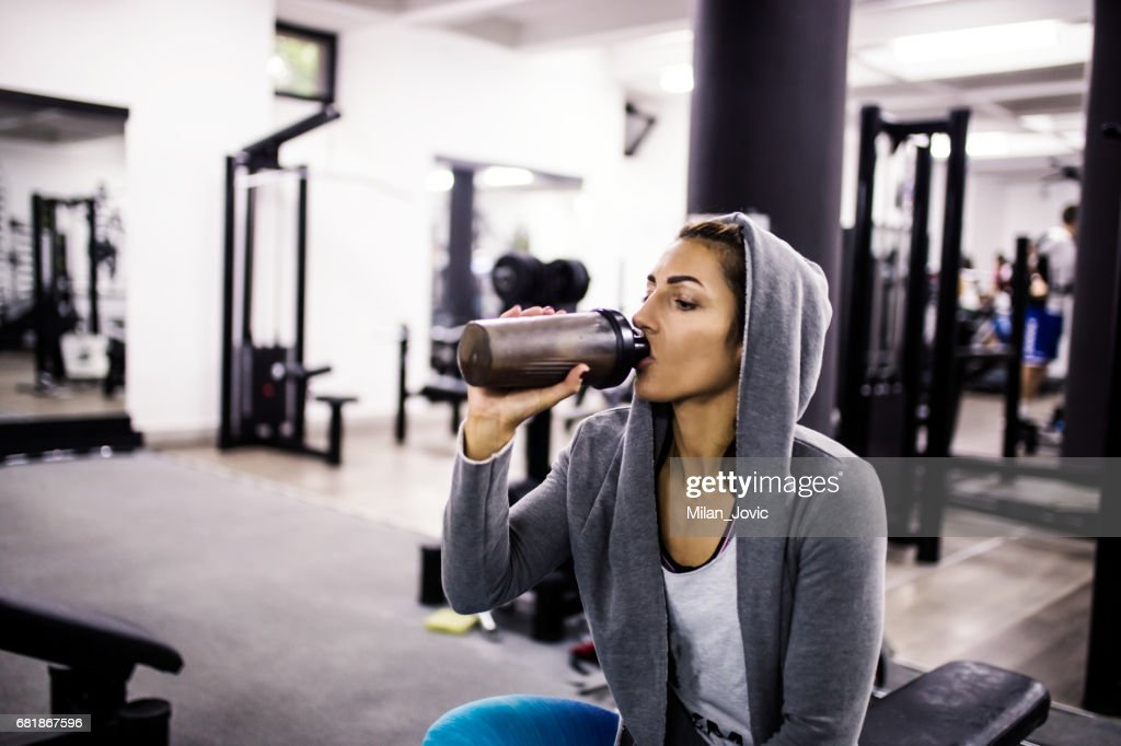 Bodybuilder girl relax after exhausting training : Stock Photo