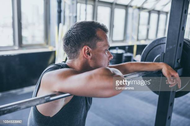 bodybuilder in the gym,posing to a photographer and resting - handsome bodybuilders stock pictures, royalty-free photos & images