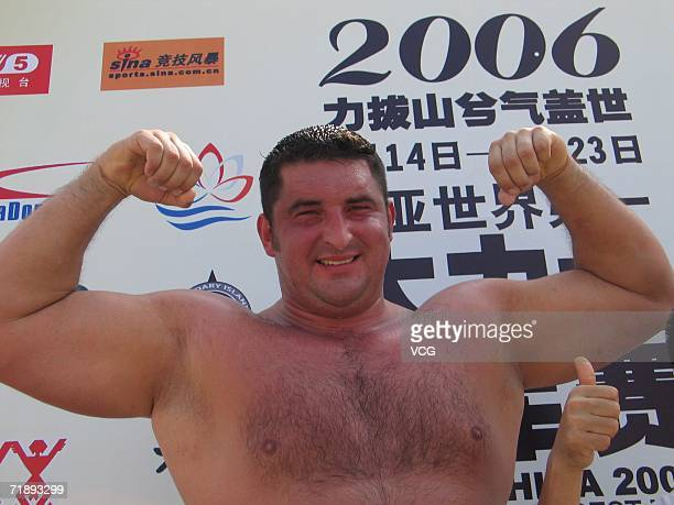 A Bodybuilder Man Shows His Muscle At 2006 TWI Worlds Strongest Contest That Opened
