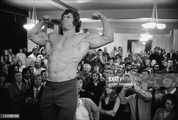 Bodybuilder Paul Grant poses before for the Mr Universe competition at his Victoria Palace London 1972
