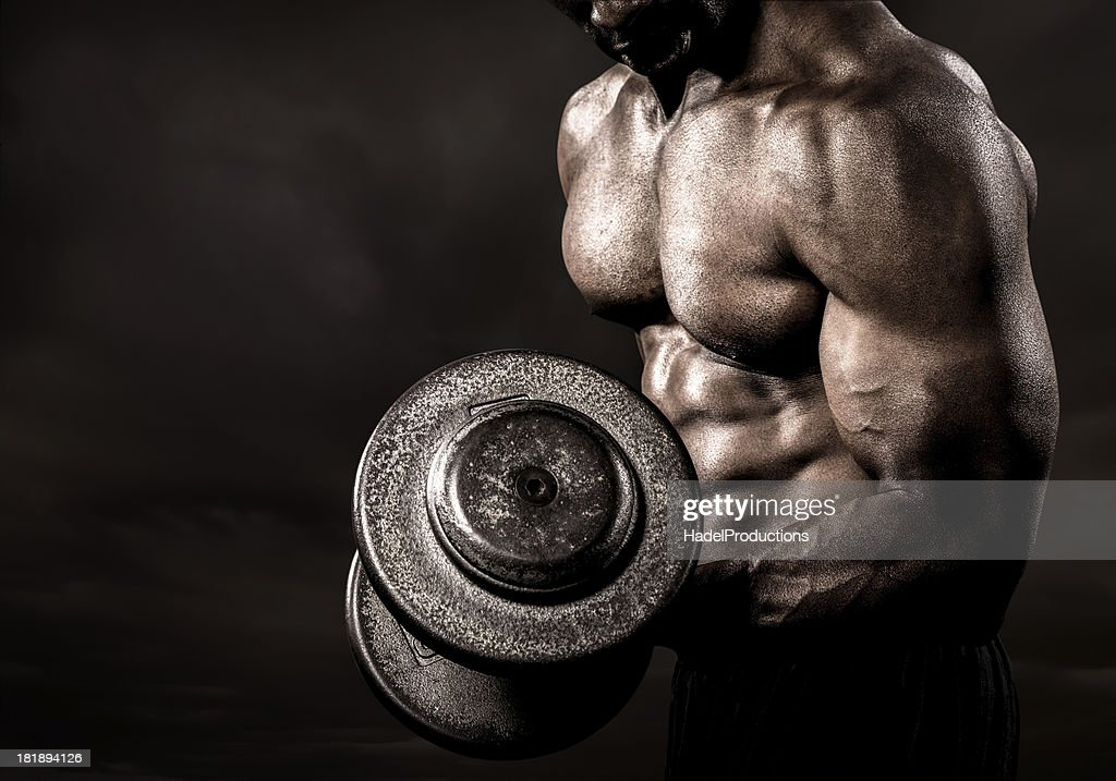 Bodybuilder performing power lift curl : Stock Photo