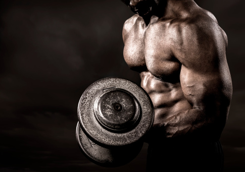Bodybuilder performing power lift curl 181894126