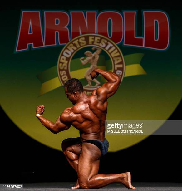 A bodybuilder performs during a competition at the fitness and bodybuilding Arnold Classic Brazil event in Sao Paulo Brazil on April 12 2019 The...
