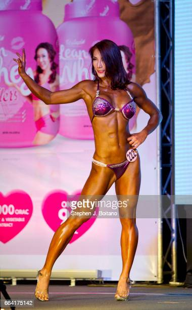 A bodybuilder poses on stage during the Fit Angel Classic at Queen Sirikit National Convention Center in Bangkok