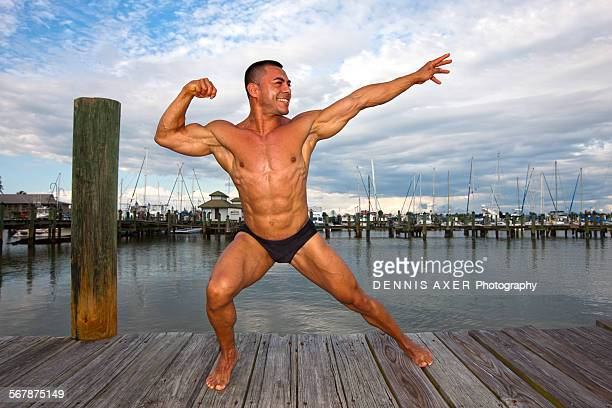 Bodybuilder posing in Naples Harbor