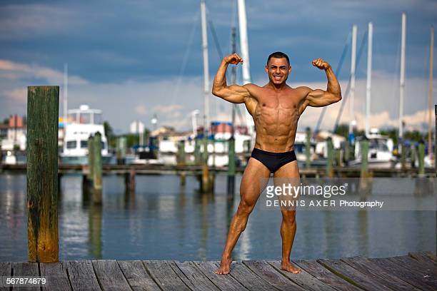 Bodybuilder posing in naples harbour
