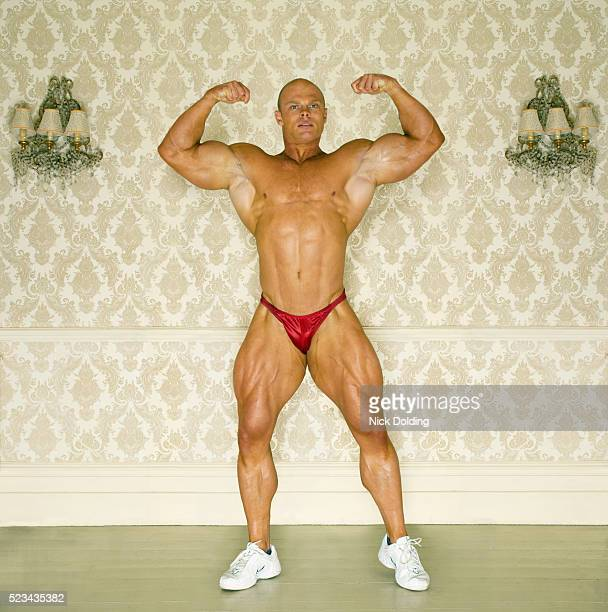 bodybuilder posing - body building stock pictures, royalty-free photos & images