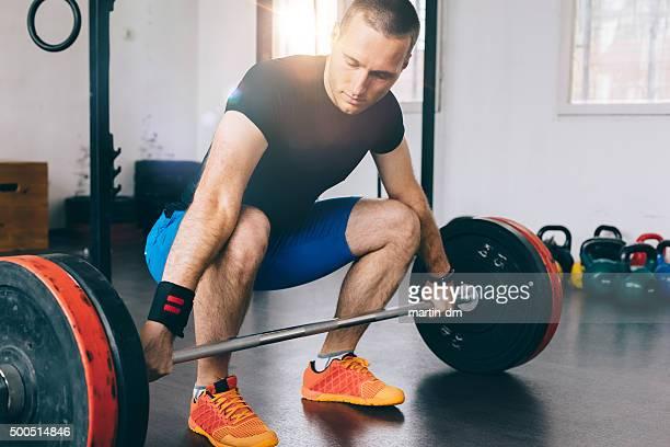 Bodybuilder weightlifting in the gym