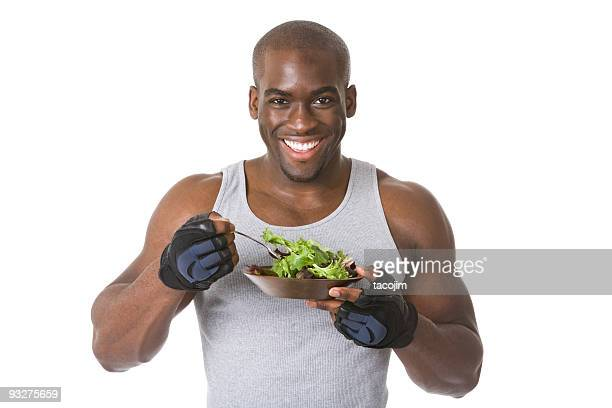 bodybuilder with salad - black male bodybuilders stock photos and pictures