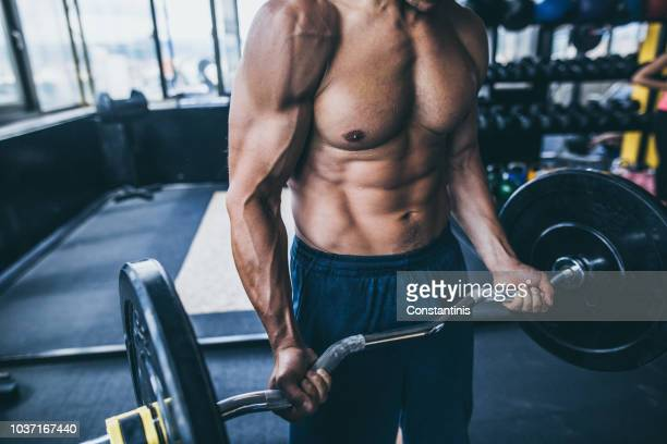 bodybuilders abdominal muscles - mass unit of measurement stock pictures, royalty-free photos & images