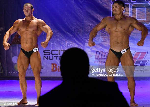 Bodybuilders contract their muscles as they perform during the Men's Classic Bodybuilding contest in Bishkek on December 16 2018