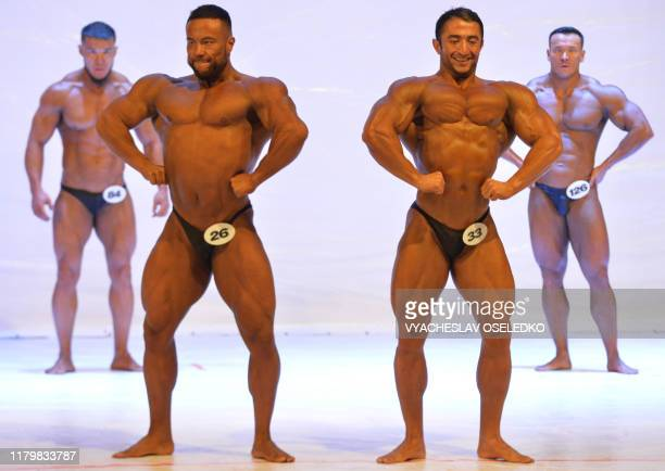TOPSHOT Bodybuilders flex their muscles as they perform during the Men's Classic Bodybuilding contest in Bishkek on November 3 2019