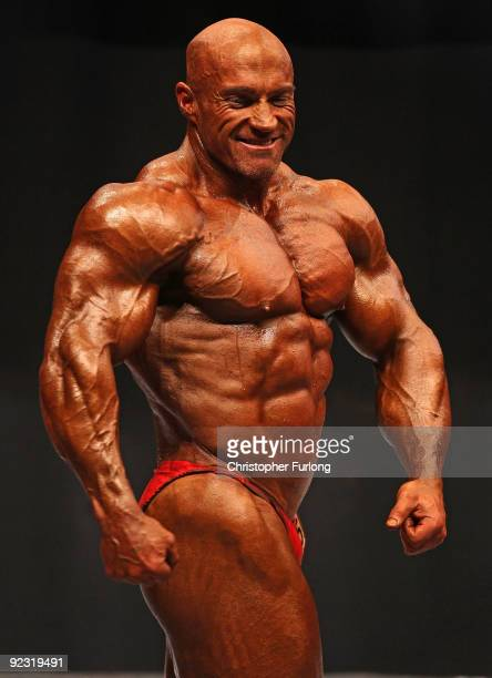 Bodybuilders pose for judges in the preliminary rounds of The Mister Universe competition at The Southport Theatre on October 24 2009 in Southport...
