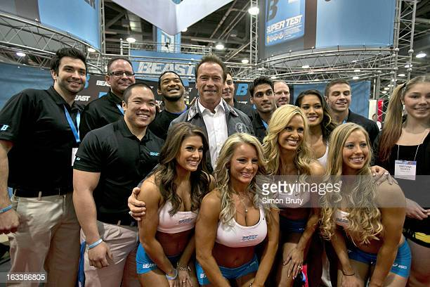 Arnold Sports Festival Arnold Schwarzenegger poses with Beast Sports Nutrition booth workers at Greater Columbus Convention Center Columbus OH CREDIT...