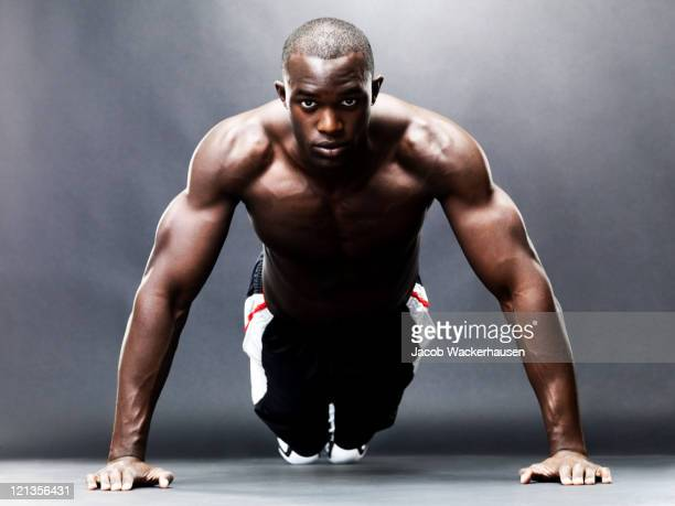 bodybuilding - healthy, young guy doing push up exercise - black male bodybuilders stock photos and pictures
