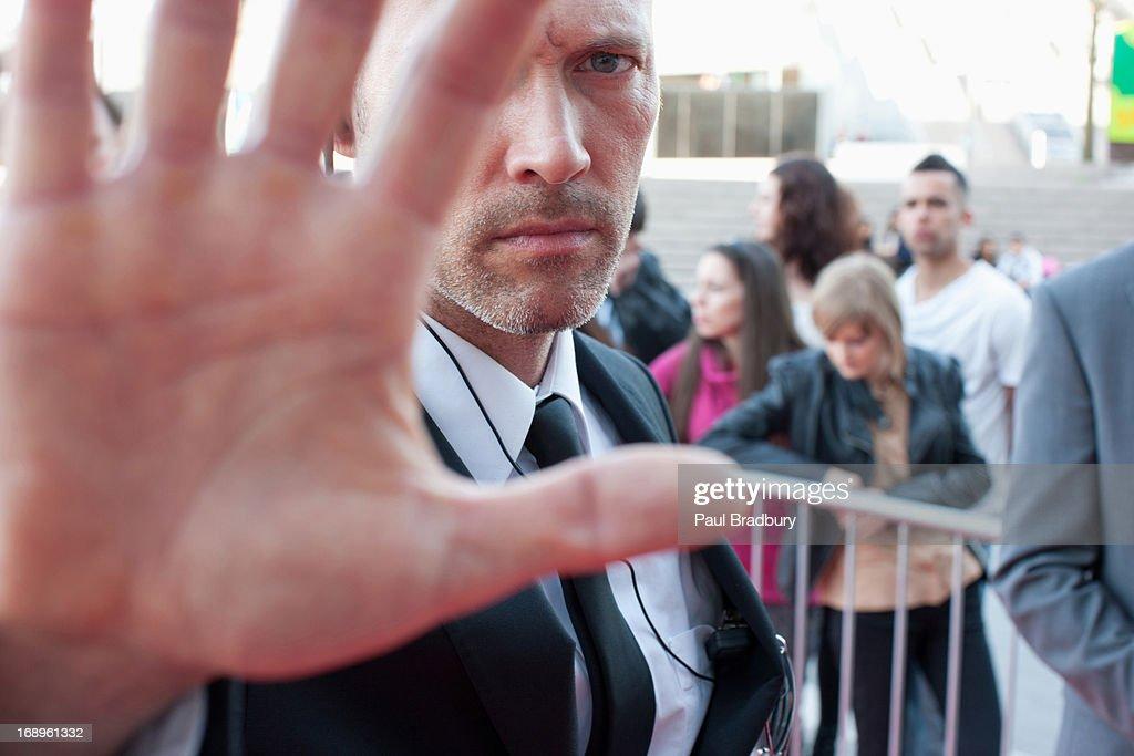 Bodyguard blocking camera : Stock Photo