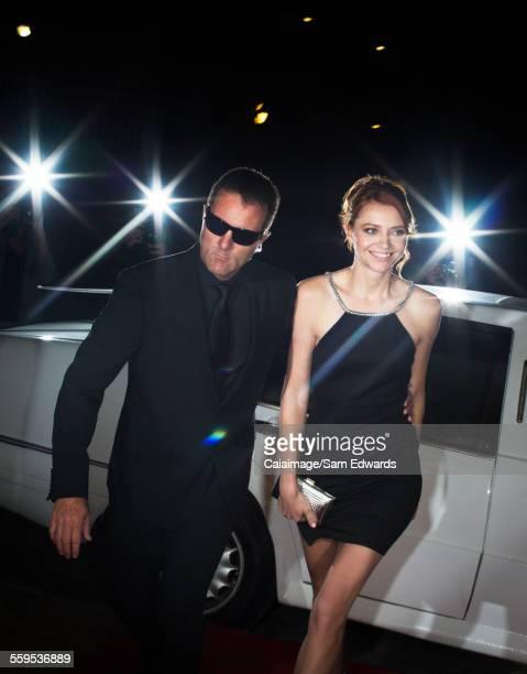 Bodyguard escorting celebrity arriving at event