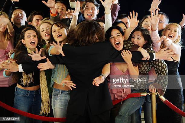 Bodyguard Holding Back Excited Fans